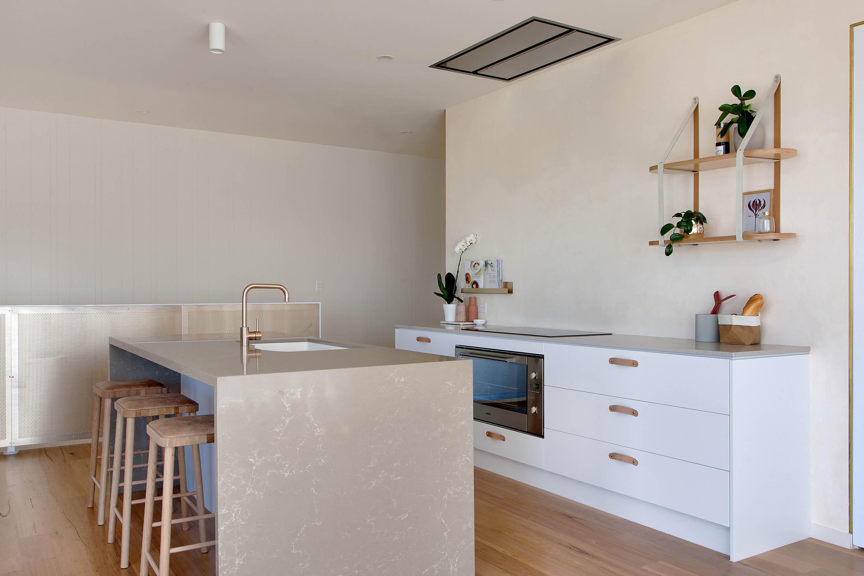 Minimalist Kitchen Design with Gold Features